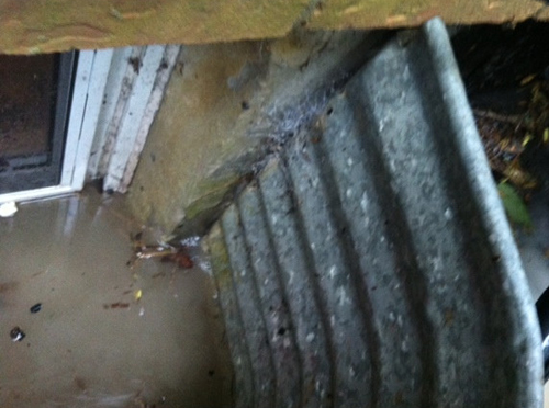 basement wall broken window well drains can lead to flooding and